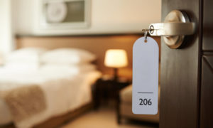 Accommodating traveler to hotel room with key in the lock